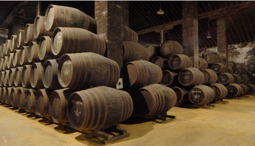 many wine barrels stored in a wine cellar